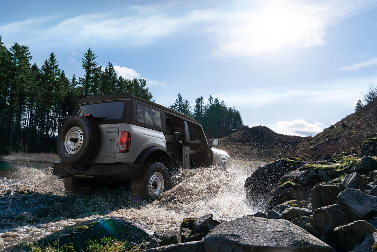 Bronco driving through river