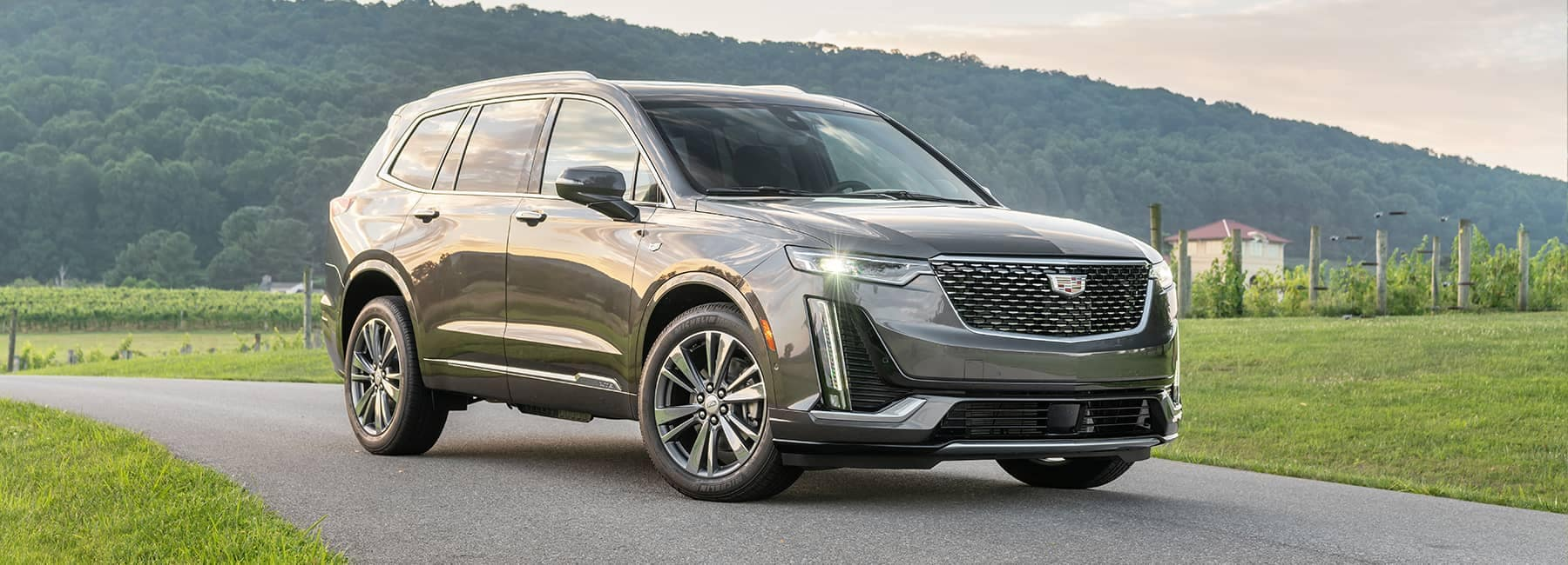 Cadillac XT5 parked next to a nice lawn